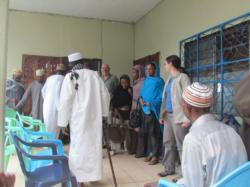 Preparing to meet chief and village elders, Comoros